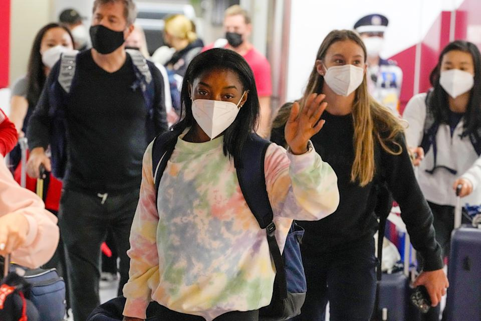 Simone Biles and the U.S. gymnastics team arrive for the Tokyo 2020 Summer Olympic Games at Narita International Airport.