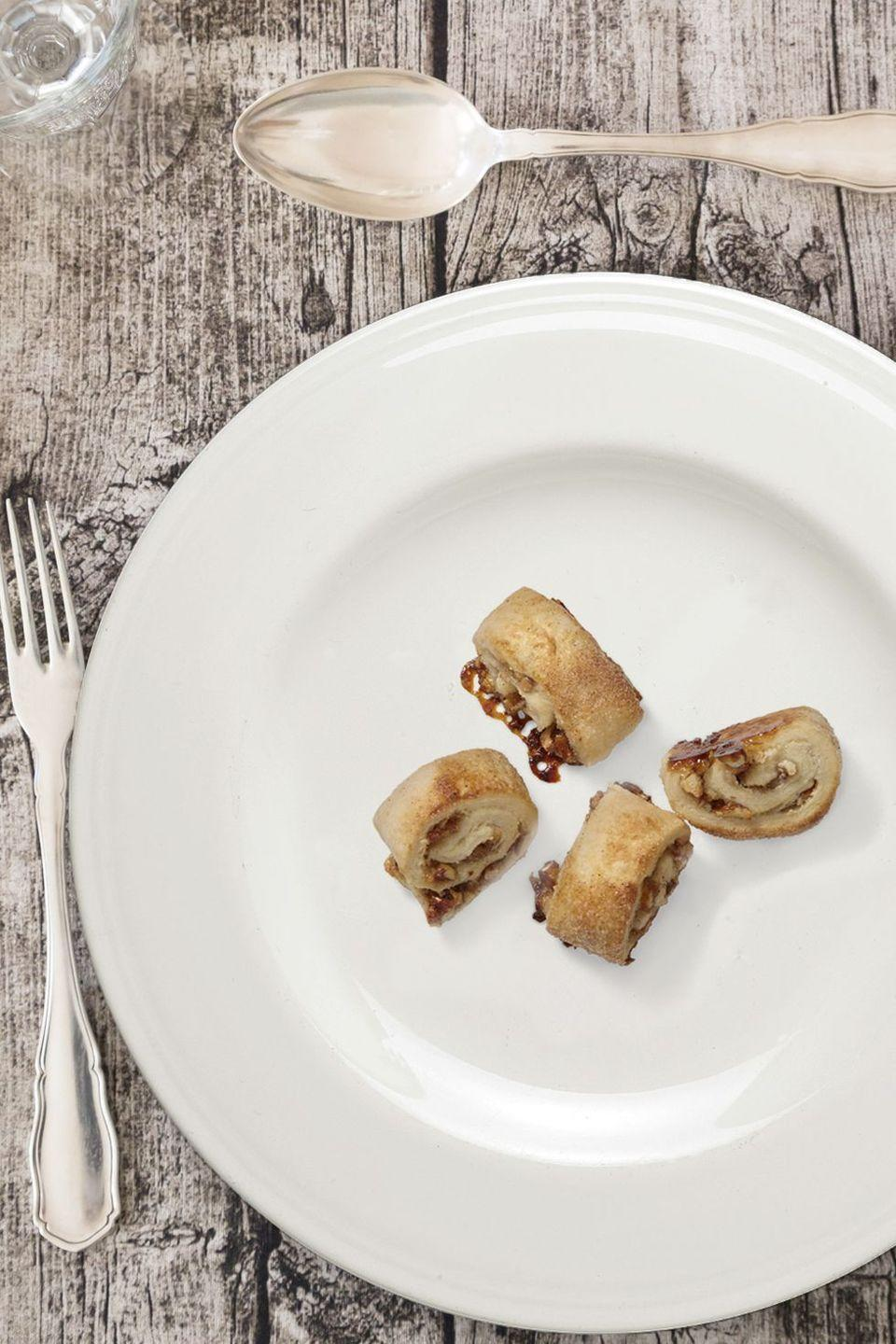 "<p>Another highly traditional Jewish baked good, rugelach is a slam-dunk comfort food crowd pleaser. Sometimes made with chocolate, fruits, or nuts, this cinnamon version calls for pecans and apricot preserves.</p><p><em><a href=""https://www.goodhousekeeping.com/food-recipes/dessert/a46638/pecan-apricot-rugelach-recipe/"" rel=""nofollow noopener"" target=""_blank"" data-ylk=""slk:Get the recipe for pecan apricot rugelach"" class=""link rapid-noclick-resp"">Get the recipe for pecan apricot rugelach </a></em></p>"