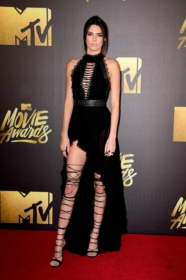 <p>Give Kenny a fierce pair of lace-up DSquared2 sandals, and she'll work them like no other. This ensemble was the star's outfit of choice at the 2016 MTV Music Awards. [Photo: Getty] </p>