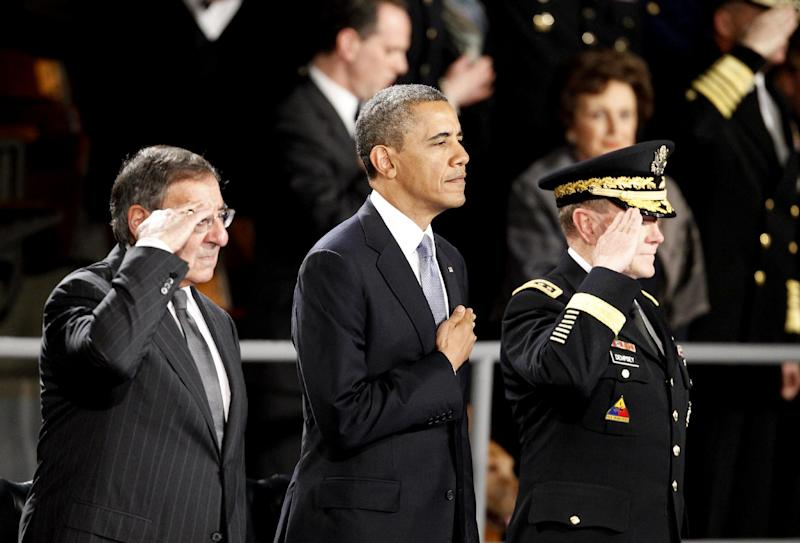 President Barack Obama attends an Armed Forces Farewell Ceremony to honor outgoing Defense Secretary Leon Panetta, left, Friday, Feb. 8, 2013, at Joint Base Myer-Henderson Hall in Arlington, Va. Joint Chiefs Chairman Army Gen. Martin Dempsey is at right. (AP Photo/Ann Heisenfelt)
