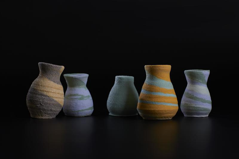 To make pâte de verre vases, Krista Israel worked with researchers to innovate how to throw glass on a potter's wheel.