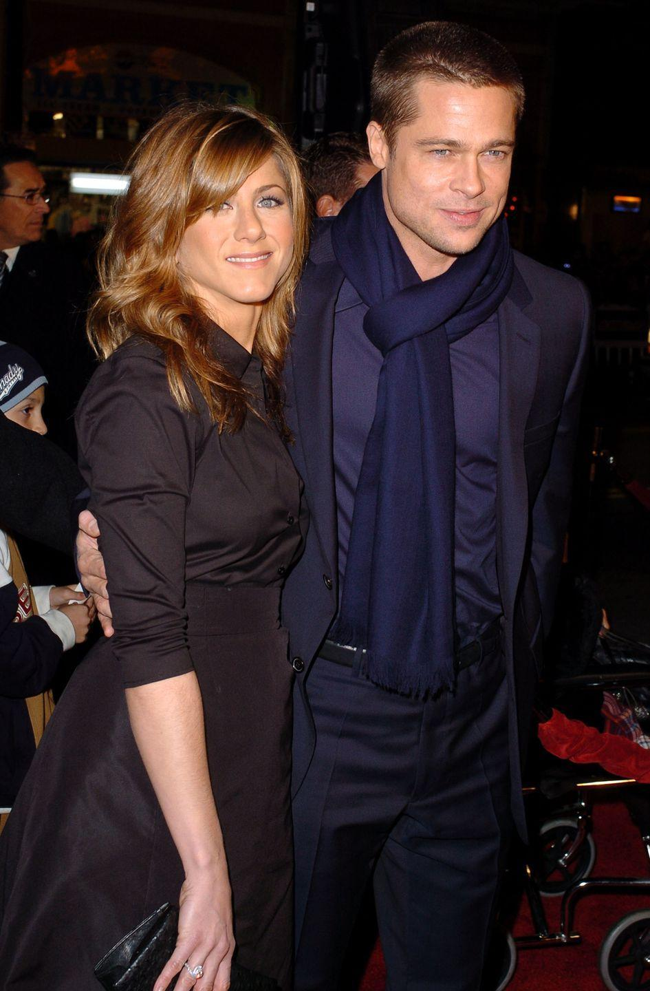 <p>Pitt accompanies Aniston to the premiere of her latest film, <em>Along Came Polly.</em></p>