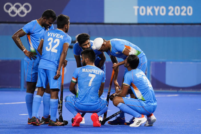 India's Manpreet Singh (7) huddles with his teammates after giving up six goals to Team Australia during a men's field hockey match at the 2020 Summer Olympics, Sunday, July 25, 2021, in Tokyo, Japan. (AP Photo/John Minchillo)