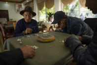 Men play a dice game at the Social Welfare Center of Chengguan District in Lhasa in western China's Tibet Autonomous Region, as seen during a rare government-led tour of the region for foreign journalists, Thursday, June 3, 2021. Long defined by its Buddhist culture, Tibet is facing a push for assimilation and political orthodoxy under China's ruling Communist Party. (AP Photo/Mark Schiefelbein)