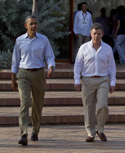 President Barack Obama, left, and Colombian President Juan Manuel Santos arrive to attend a joint news conference during the 6th Summit of the Americas in Cartagena, Colombia, Sunday, April 15, 2012. (AP Photo/Carolyn Kaster)