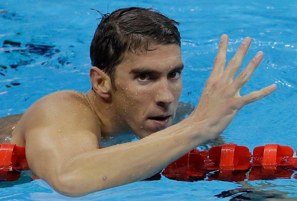 United States' Michael Phelps celebrates winning gold in the men's 200-meter individual medley during the swimming competitions at the 2016 Summer Olympics, Thursday, Aug. 11, 2016, in Rio de Janeiro, Brazil. (AP Photo/Natacha Pisarenko)