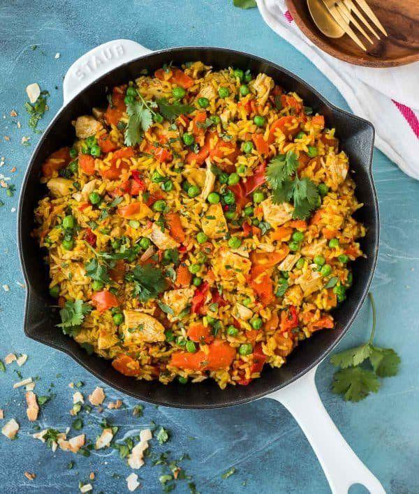 """<strong>Get the <a href=""""https://www.wellplated.com/golden-instant-pot-chicken-and-rice/"""" target=""""_blank"""">Golden Instant Pot Chicken and Rice</a> recipe from Well Plated</strong>"""