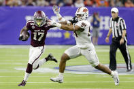Texas A&M wide receiver Ainias Smith (17) fends off Oklahoma State defensive end Trace Ford (94) during the first half of the Texas Bowl NCAA college football game Friday, Dec. 27, 2019, in Houston. (AP Photo/Michael Wyke)