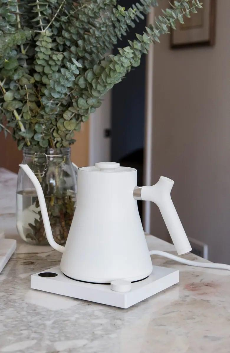 <p>The minimal design of this <span>Stagg EKG Electric Pour Over Kettle</span> ($149) is perfect for their countertop.</p>