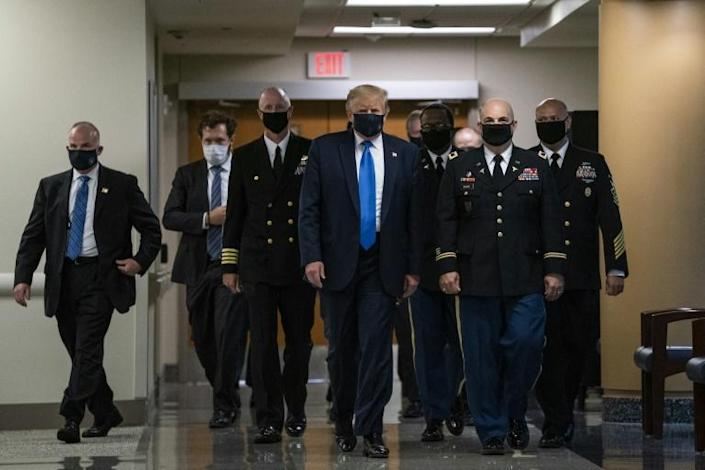 US President Donald Trump told reporters before leaving for Walter Reed medical center: 'I've never been against masks but I do believe they have a time and a place' (AFP Photo/ALEX EDELMAN)