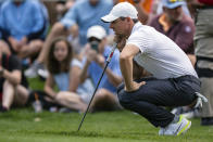 Rory McIlroy lines up his putt on the first hole during the third round of the Wells Fargo Championship golf tournament at Quail Hollow on Saturday, May 8, 2021, in Charlotte, N.C. (AP Photo/Jacob Kupferman)