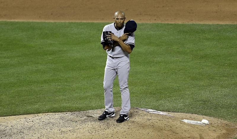 American League's Mariano Rivera, of the New York Yankees, acknowledges the crowd as he is introduced during the eighth inning of the MLB All-Star baseball game, on Tuesday, July 16, 2013, in New York. (AP Photo/Julio Cortez)