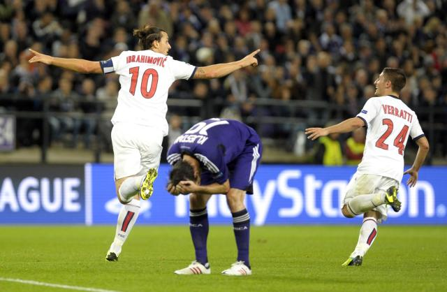 Paris Saint-Germain's Zlatan Ibrahimovic (L) react with Marco Verratti (R) after scoring a hattrick against Anderlecht during their Champions League soccer match at Constant Vanden Stock stadium in Brussels October 23, 2013. REUTERS/Laurent Dubrule (BELGIUM - Tags: SPORT SOCCER)