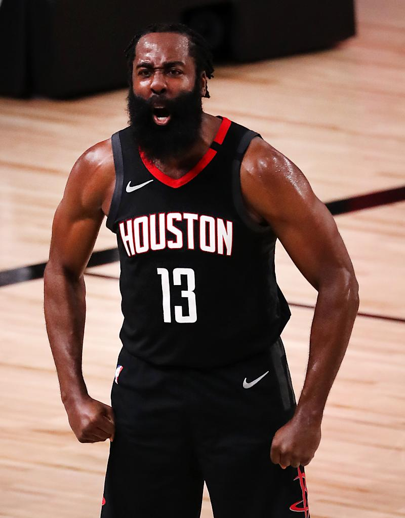 Rockets star James Harden reacts after making the game-saving block. (Mike Ehrmann/Getty Images)