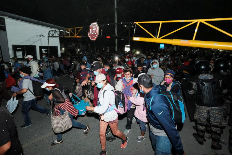 Hondurans take part in a new caravan of migrants, set to head to the United States, in El Florido