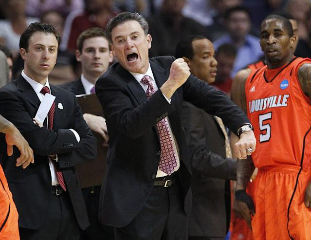 Louisville coach Rick Pitino reacts during the first half of an NCAA men's college basketball tournament West Regional semifinal against Michigan State on Thursday, March 22, 2012, in Phoenix. (AP Photo/Matt York)