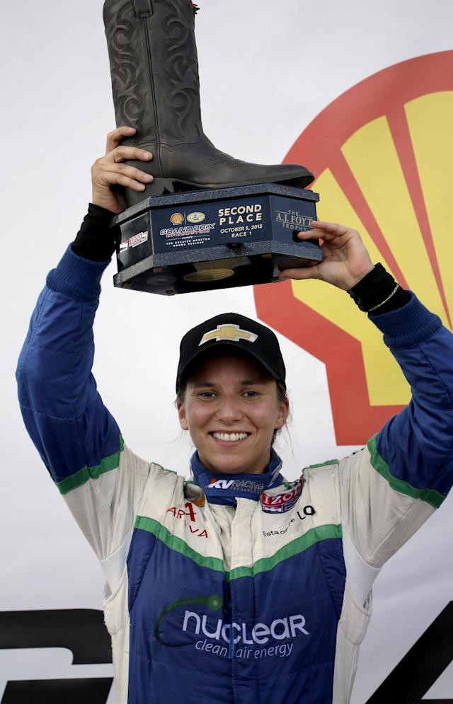Simona De Silvestro, of Switzerland, holds up her trophy after finishing second in the first IndyCar Grand Prix of Houston auto race, Saturday, Oct. 5, 2013, in Houston. (AP Photo/David J. Phillip)
