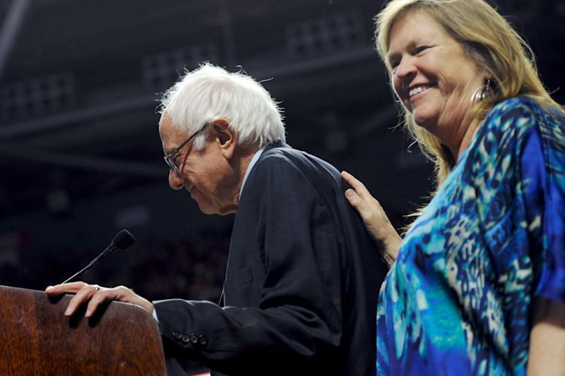 Jane Sanders, wife of Democratic U.S. presidential candidate Sanders, rests her hand on his back before his speech at a campaign rally in Philadelphia, Pennsylvania
