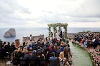 "<p>This wedding aisle and ceremonial chuppah in Capri was inspired by the bride's love of fashion—and a stunning runway show. ""Most aisles are straight, but [Jung Lee of] <a href=""http://feteny.com/"" rel=""nofollow noopener"" target=""_blank"" data-ylk=""slk:Fête NY"" class=""link rapid-noclick-resp"">Fête NY</a> created an organic pathway delineated with thousands of pale pink carnations, inspired by a photo of Tory Burch's Fall 2018 fashion show,"" said the bride. Situated (seemingly) on the edge of the Earth, this ceremony was studded with thousands of flowers, allowing guests to feel as though they'd walked through a field to reach the couple's epic ceremony site. </p><p>Get the look by seeking inspiration from your favorite fashion shows when designing your aisle, whether it's Jacquemus' romantic catwalks in the lavender fields or wheat fields of the South of France, or Oscar de la Renta's epic showcase in the New York Public Library.</p><p><em>Pictured: <a href=""https://www.harpersbazaar.com/wedding/photos/a27482104/jamie-bernfield-seth-birkan-wedding/"" rel=""nofollow noopener"" target=""_blank"" data-ylk=""slk:Jamie Bernfield and Seth Birkan's wedding in Capri"" class=""link rapid-noclick-resp"">Jamie Bernfield and Seth Birkan's wedding in Capri</a>. Planning by Jung Lee of <a href=""http://feteny.com/"" rel=""nofollow noopener"" target=""_blank"" data-ylk=""slk:Fête NY"" class=""link rapid-noclick-resp"">Fête NY</a>.</em></p>"