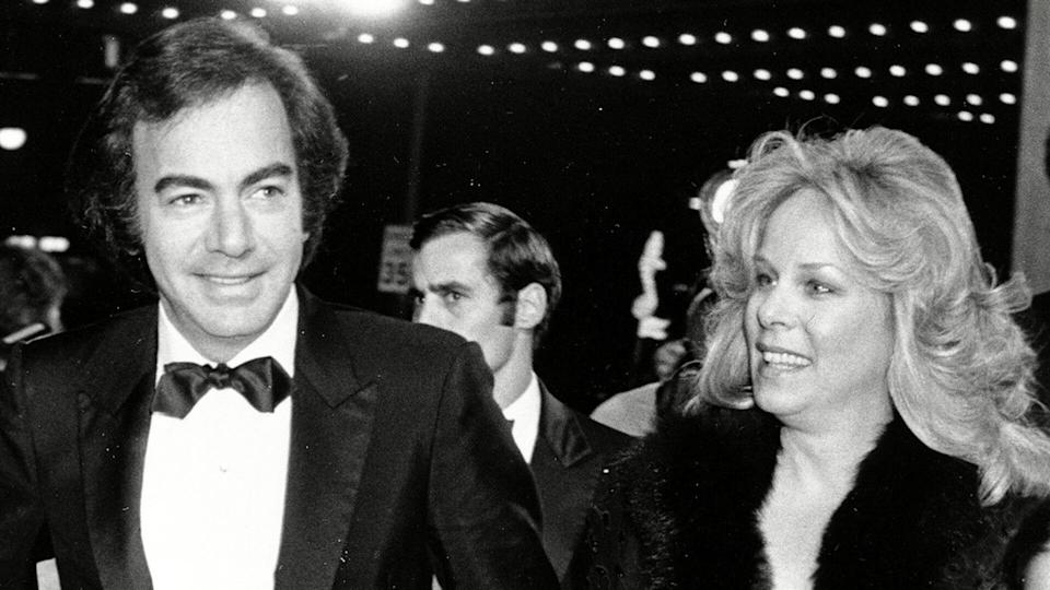 "Mandatory Credit: Photo by HARMS/AP/REX/Shutterstock (6592248a)Diamond Singer Neil Diamond arrives with his wife, Marcia, and daughter, Elyn, at the premiere of ""The Jazz Singer,"" in Century City, Ca."