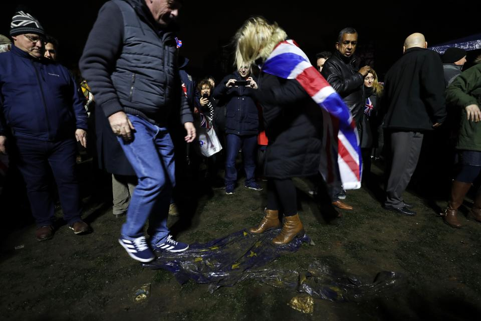 Brexit supporters trample on a European Union flag during a rally in London. (AP)