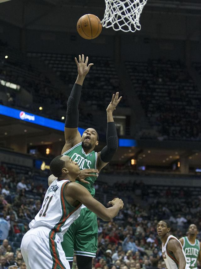 Milwaukee Bucks' John Henson Guards Boston Celtics' Jared Sullinger during the first half of an NBA basketball game Saturday, Nov. 30, 2013, in Milwaukee. (AP Photo/Tom Lynn)