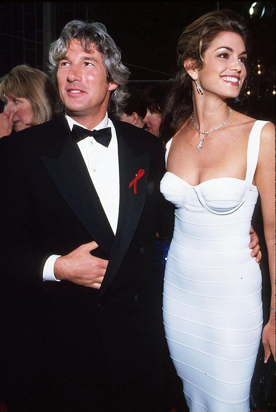 <p>The model's skin-tight bandage dress accentuated her figure as she graced the red carpet with then-husband Richard Gere, who was a presenter that evening. </p>