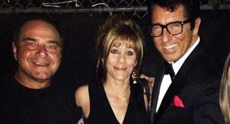Michelle Weissman, 56, is pictured with two other men.