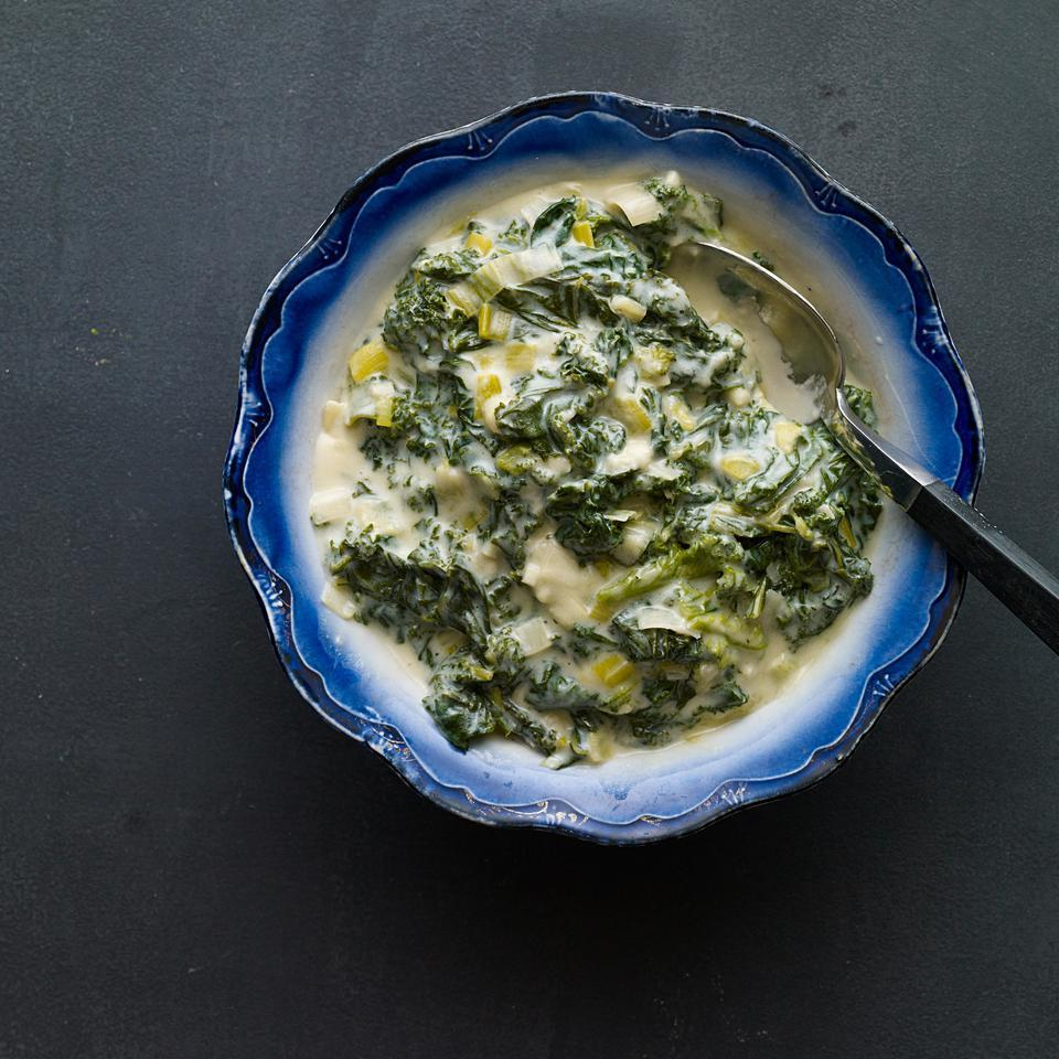 """<p>Kale is simmered with leeks and garlic then """"creamed"""" with flour and milk in this healthy take on creamed spinach. Serve alongside steak or roast chicken and a baked potato. <a href=""""http://www.eatingwell.com/recipe/251248/creamed-kale/"""" rel=""""nofollow noopener"""" target=""""_blank"""" data-ylk=""""slk:View recipe"""" class=""""link rapid-noclick-resp""""> View recipe </a></p>"""