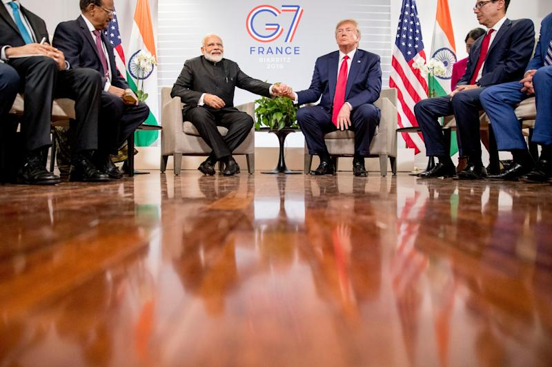 President Donald Trump and Indian Prime Minister Narendra Modi shake hands during a bilateral meeting at the G-7 summit in Biarritz, France, Monday.