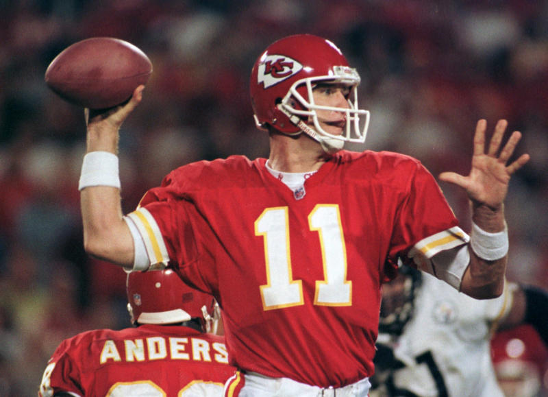 FILE - In this Oct. 26, 1998, file photo, Kansas City Chiefs quarterback Elvis Grbac throws against the Pittsburgh Steelers during the second quarter in Kansas City, Mo.  Grbac signed with the Chiefs in 1997 for the chance to be the starter. He started the first nine games that season before getting hurt, but helped Kansas City win the AFC West. Grbac returned for the season finale and then lost the playoff opener at home to Denver. (AP Photo/Ed Zurga, File)