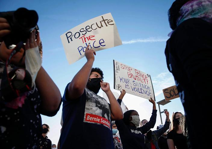 Jaylen Cavil of Des Moines holds a sign as he joins thousands of protesters outside the Des Moines Police Department in Des Moines during a protest on Friday, May 29, 2020. The protests were a response to the recent death of George Floyd, a Minneapolis resident who was killed by a Minneapolis police officer.