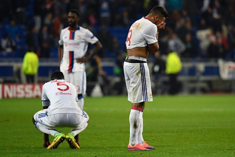 Lyon's Mouctar Diakhaby (L) and Corentin Tolisso (R) react at the end of their Champions League football match against Juventus on October 18, 2016 in Decines-Charpieu near Lyon, southeastern France (AFP Photo/Philippe Desmazes)