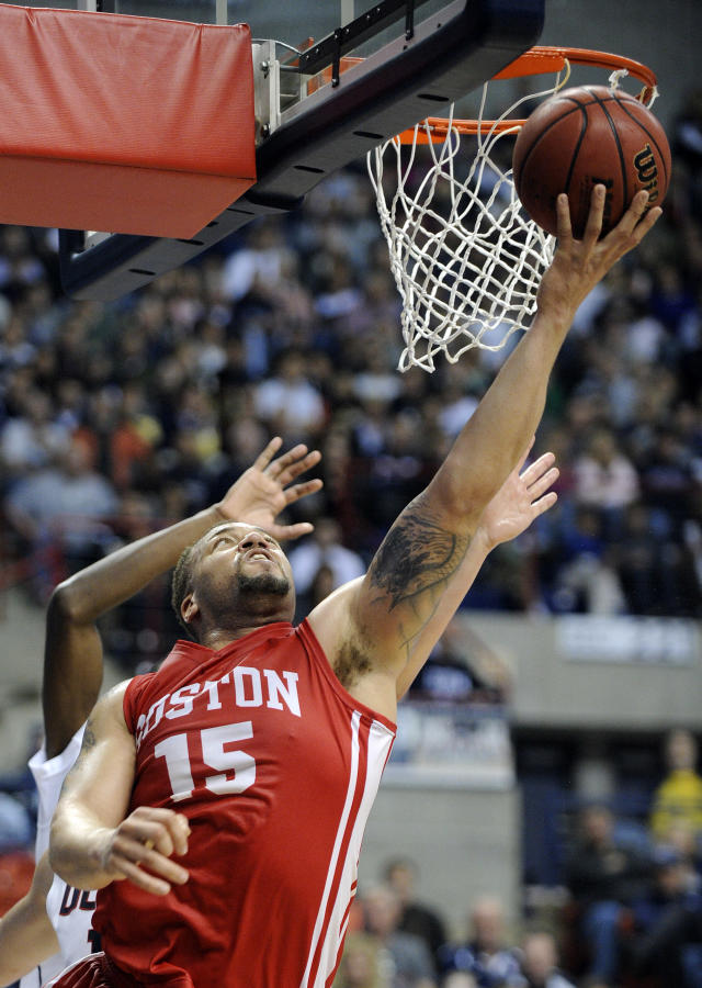 Boston University's Dom Morris (15) drives to the basket during the first half of an NCAA college basketball game against Connecticut in Storrs, Conn., on Sunday, Nov. 17, 2013. (AP Photo/Fred Beckham)