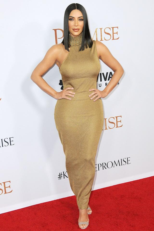 <p>In Vintage Gianni Versace Haute Couture at the LA premiere of 'The Promise'<span></span></p>