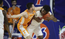 Tennessee forward John Fulkerson, left, fouls Florida forward Omar Payne during the first half of an NCAA college basketball game Tuesday, Jan. 19. 2021, in Gainesville, Fla. (AP Photo/Matt Stamey)