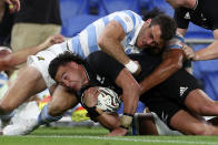 CORRECT'S NEW ZEALAND PLAYER'S NAME - New Zealand's David Havili, left, drives through Argentina's Bautista Delguy during their Rugby Championship match on Sunday, Sept. 12, 2021, on the Gold Coast, Australia. (AP Photo/Tertius Pickard)