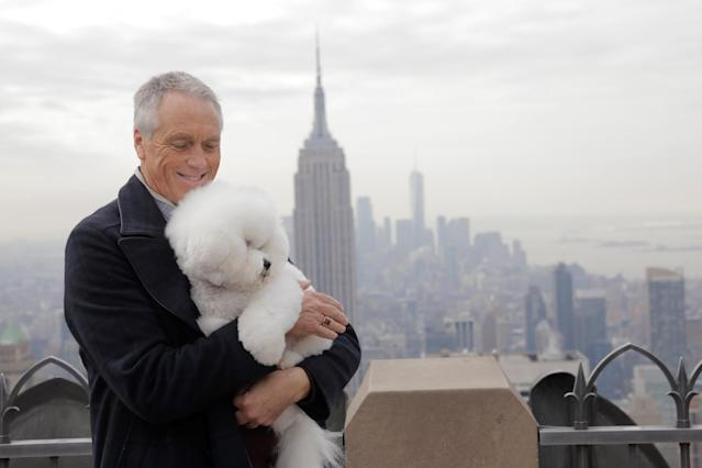 Flynn, a bichon frise and winner of Best In Show at the 142nd Westminster Kennel Club Dog Show, poses with handler Bill McFadden at the Top of the Rock in New York, U.S., February 14, 2018. REUTERS/Lucas Jackson