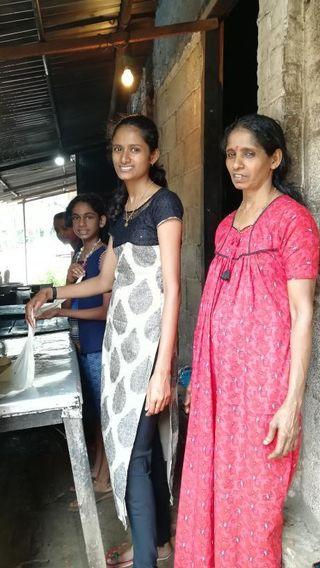 Anaswara with her mother Suby Hari helping her family at the hotel