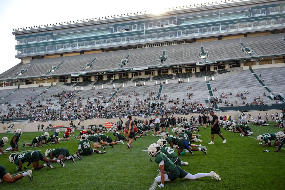 Michigan State stretches during the Meet the Spartans open football practice on Monday, Aug. 23, 2021, at Spartan Stadium in East Lansing.
