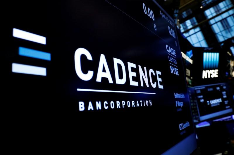 A logo and ticker info for Cadence Bancorp, LLC is displayed on a screen during the company's IPO, on the floor of the NYSE