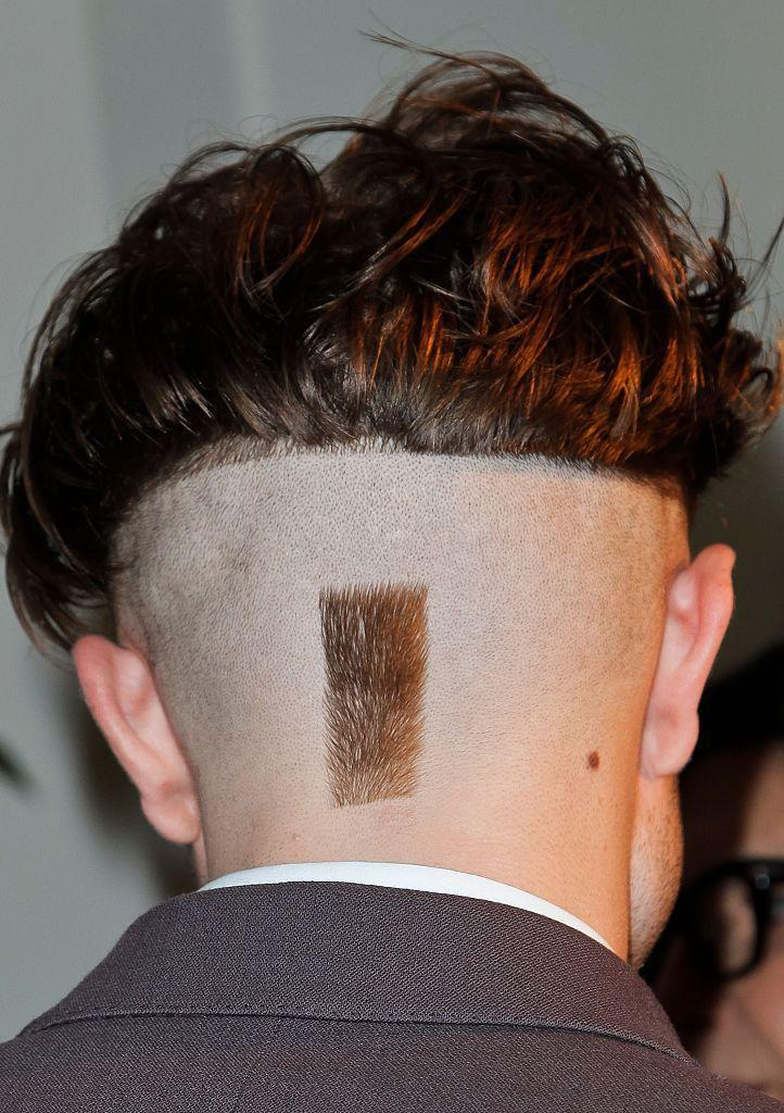 """<p>The <em>Twilight</em> actor is usually dapper and sharp on the red carpet, so when he showed up sporting this buzzed haircut with a stripe in the back, everyone let out a collective """"<em>What?</em>""""</p>"""