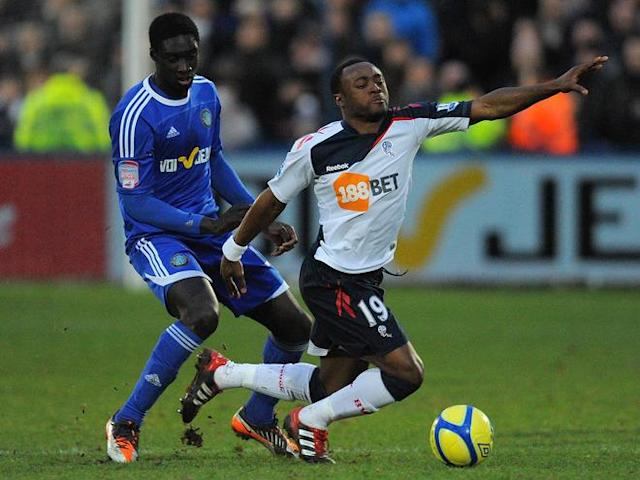"Macclesfield Town's Guinean midfielder Arnaud Mendy (L) vies with Bolton Wanderers' English midfielder Nigel Reo-Coker during the FA Cup football match between Macclesfield Town and Bolton Wanderers at Moss Rose, in Macclesfield, north-west England, on January 7, 2012. (Photo by Andrew Yates. Restricted To Editorial Use. No Use With Unauthorized Audio, Video, Data, Fixture Lists, Club/league Logos Or ""live"" Services. Online In-match Use Limited To 45 Images, No Video Emulation. No Use In Betting, Games Or Single Club/league/player Publications. /AFP/Getty Images)"