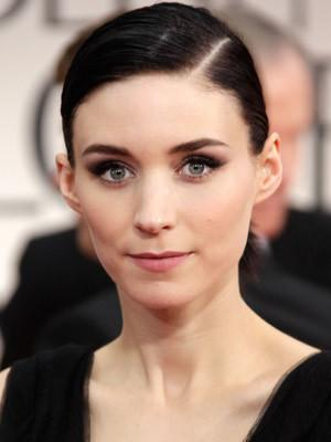 <p>Girl of the moment Rooney Mara from Girl with a Dragon Tattoo spots a sleek side parting.</p>