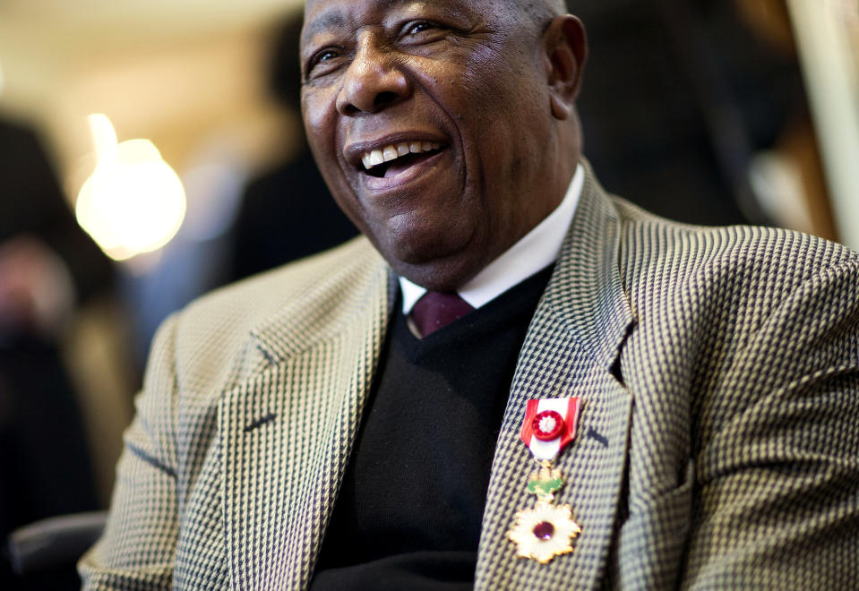 Hank Aaron smiles after being presented with the Order of the Rising Sun, Gold Rays with Rosette by the Consul General of Japan at his official residence Thursday, Jan. 14, 2016, in Atlanta. Japan has honored the former home run king with one of its highest awards, bestowing the Order of the Rising Sun for bringing young people and countries together through baseball. (AP Photo/David Goldman)