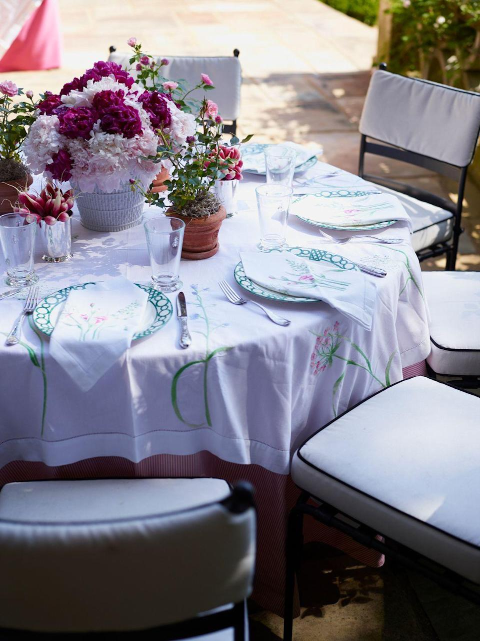 """<p>""""Repeating patterns of flowering plants and clipped greenery add drama and make for a festive table."""" <em>—<a href=""""https://danielledrollins.com/"""" rel=""""nofollow noopener"""" target=""""_blank"""" data-ylk=""""slk:Danielle Rollins"""" class=""""link rapid-noclick-resp"""">Danielle Rollins</a>, Interior Designer </em><br></p>"""