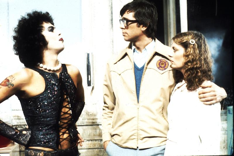 "1975: Actors Tim Curry, Barry Bostwick and Susan Sarandon in scene from movie ""The Rocky Horror Picture Show"" directed by Jim Sharman. (Photo by Michael Ochs Archives/Getty Images)"