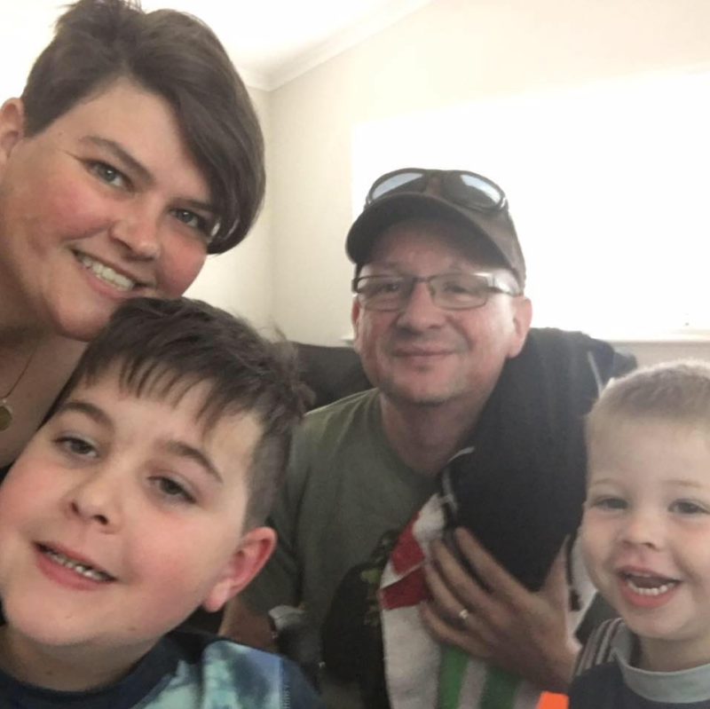 Photo of Perth family Amy, Luke, Logan (left) and Flynn (right) who are battling a health crisis.