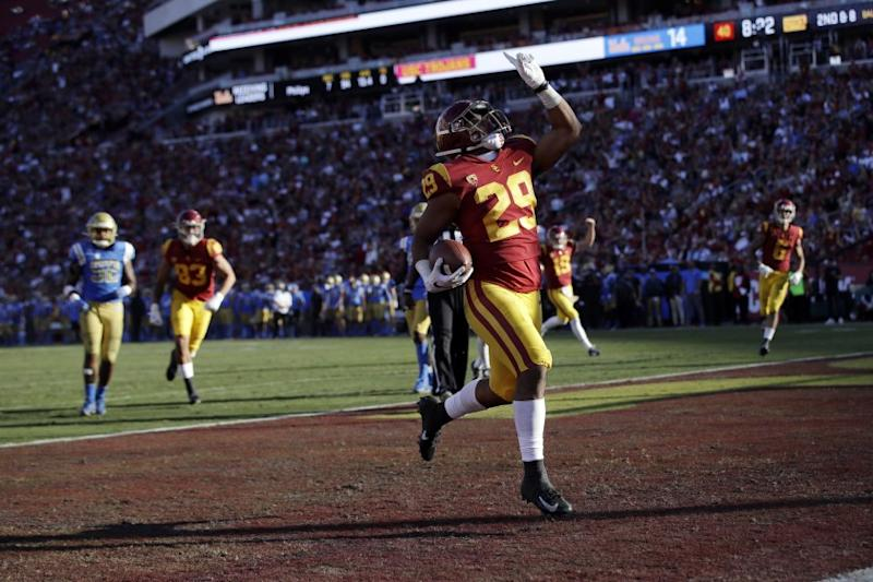 Southern California running back Vavae Malepeai (29) celebrates as he scores a touchdown against UCLA during the second half of an NCAA college football game, Saturday, Nov. 23, 2019, in Los Angeles. (AP Photo/Marcio Jose Sanchez)