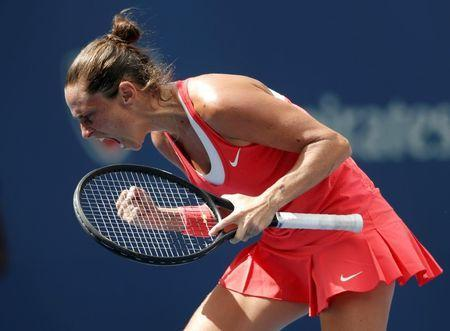 Roberta Vinci of Italy celebrates winning the second set against Serena Williams of the U.S. during their women's singles semi-final match at the U.S. Open Championships tennis tournament in New York, September 11, 2015. REUTERS/Mike Segar Picture Supplied by Action Images